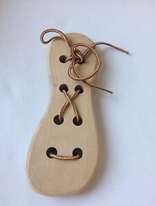 Wooden toy to practice lacing