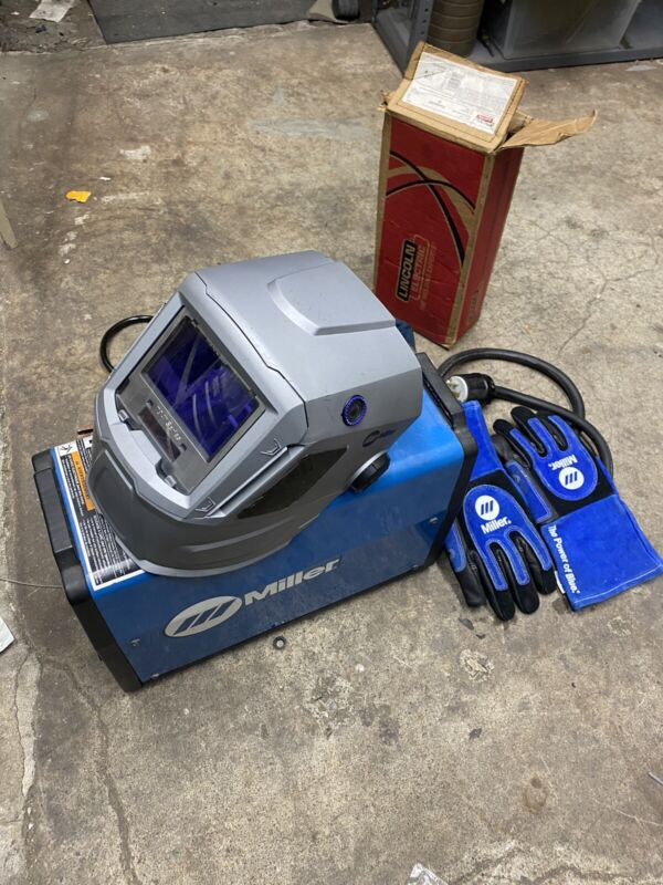 Miller CST 280 /TIG Welder with Miller T94 helmet,Gloves, and cables barely used