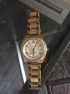 Female Michael Kors Gold Watch