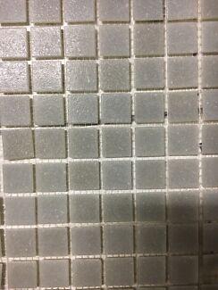 Light grey mosaic tiles