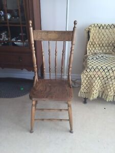 Pressed back antique wooden chair, will take best offer.
