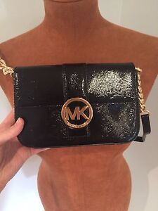 Two Authentic Micheal Kors Purses