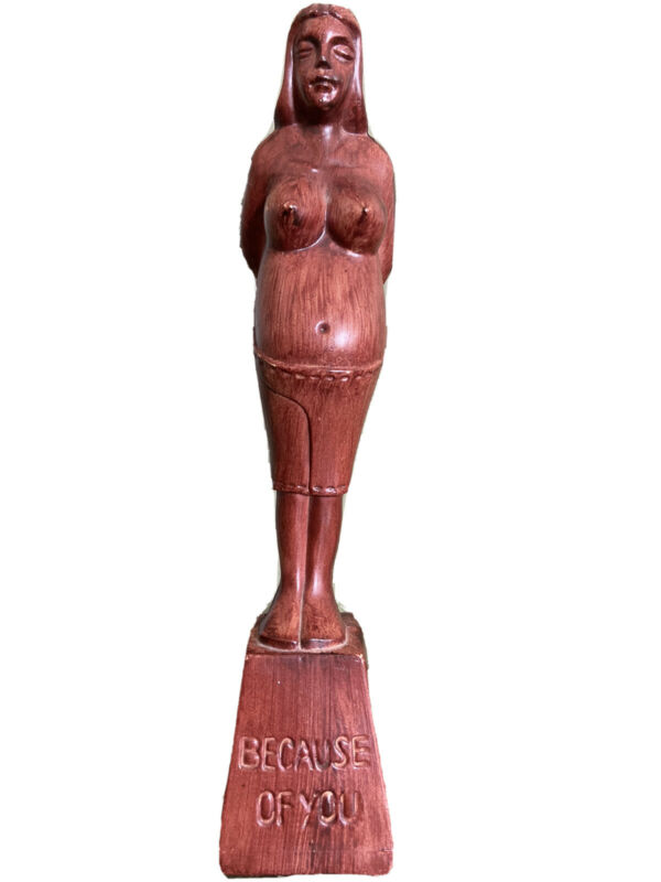 beautiful pregnant wooden statue
