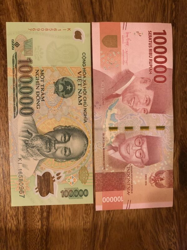 Indonesia And Vietnam 100000 Rupiah And Vietnam Dong Banknotes. 2 Notes Total.
