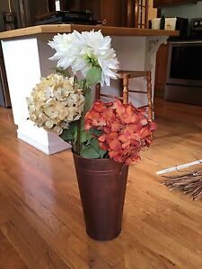 Beautiful faux flowers and bucket