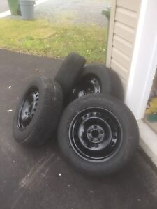 4 Michelin x-ice tires and ford rims