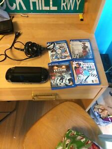 PS Vita with four games and a charger