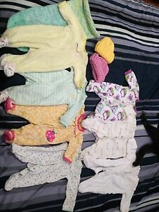 newborn sleepers, hats, and bundle bag.