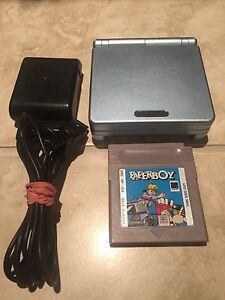 Pearl Blue Nintendo Gameboy Advance SP AGS-101 and Paperboy
