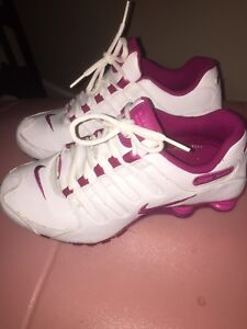 Nike woman's pink and white shoxs