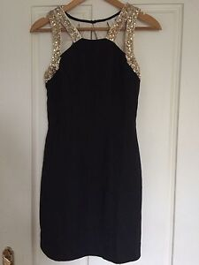 Xenia boutique size 10 black and gold back detail dress Lyons Woden Valley Preview