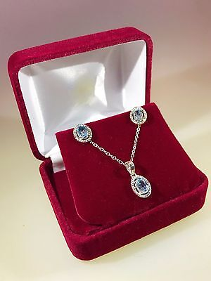 Sterling Silver Light Blue Topaz Oval Necklace and Earring Set with Diamonds