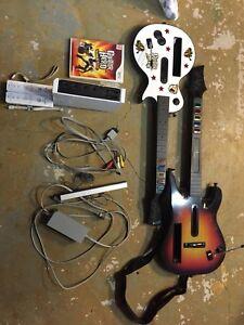 Console Wii + Guitar Hero World Tour