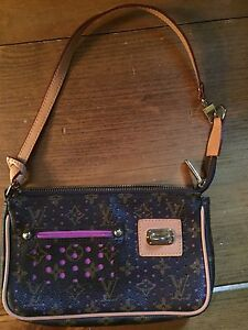 REPLICA Louis Vuitton perforated pochette handbag.