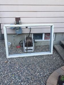 Wood frame window with aluminum sliders