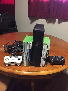 Xbox 360 with 2 remotes and random games
