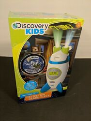 Discovery Kids Roketship Alarm Clock Ages 3+. Projects celestial images and time