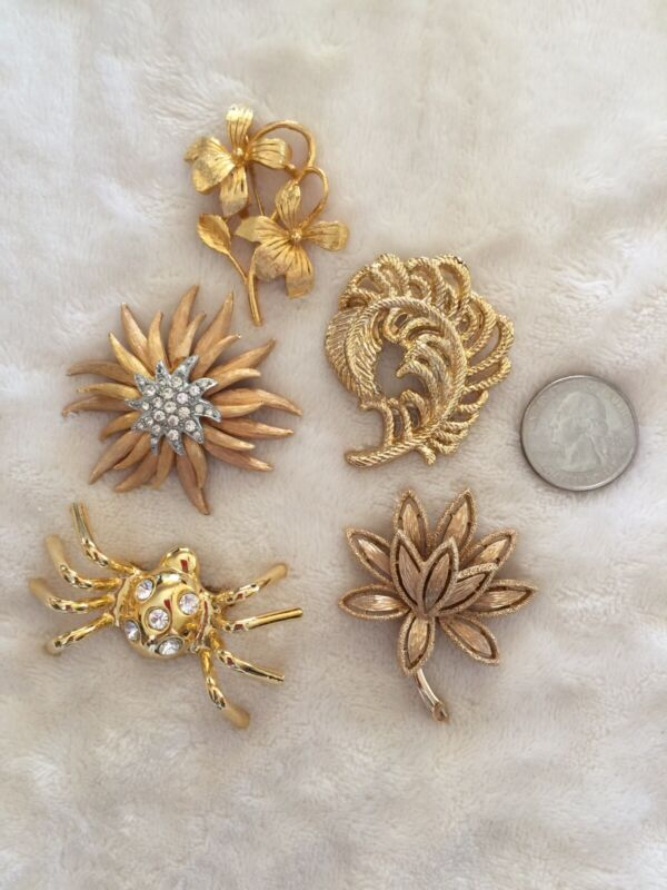 Lot of 5 Vintage And Mod Gold Tone Assorted Pins Brooches Signed Avon Rhinestone