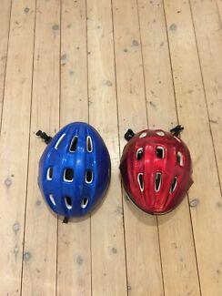 2 bike helmets blue and red