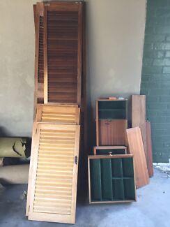 Louvred Timber bi-fold doors, drawers, desk and cladding