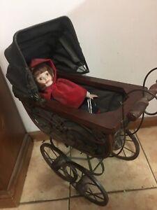 Vintage pram including little red riding hood