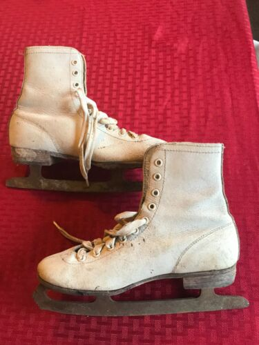 Girls vintage ice skates for holiday decorations