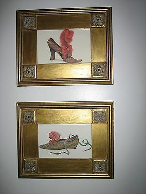 A pair of beautifully framed reproduction of 18th century style women's shoes.