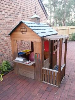 Cubby House - wooden with shingled plastic roof.