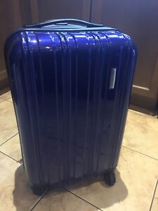 Samsonite Kids or carry-on hard cover suitcase