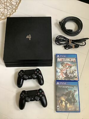 Sony PlayStation 4 Pro 1TB Console - PS4 Pro - 2 controllers & 2 games Bundle