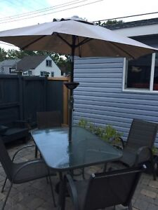 Patio table umbrella with 4 chairs