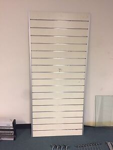 2 Slat wall panels with hooks, arms and 2 glass shelves. Parkinson Brisbane South West Preview
