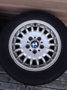 4 WINTER TIRES ON BMW RIMS