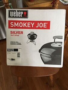 New in box!!!! Smokey Joe by Weber charcoal grill