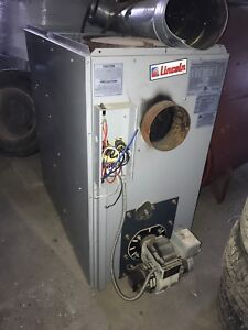 Lincoln forced air oil furnace and oil tank