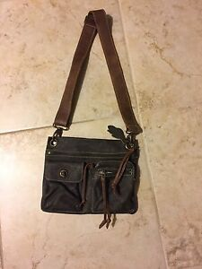 Roots and MK handbags for sale