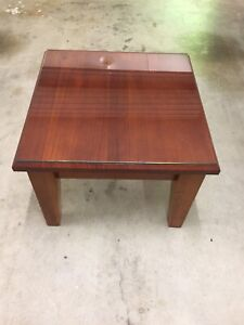 Beautiful stained timber coffee table with a clear glass top.