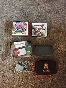 3ds XL With games, charger and box. 10/10 condition