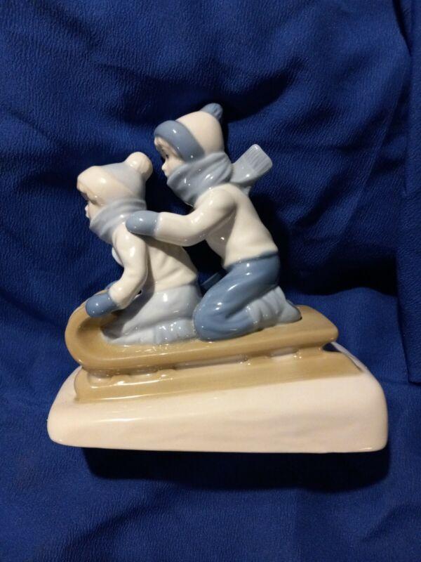 1992 Paul Sebastian Sledding Figurine Lladro Style Blue & White Porcelain Mexico