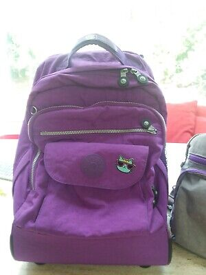Lightly used Kipling Sanaa Purple Backpack Rolling wheels