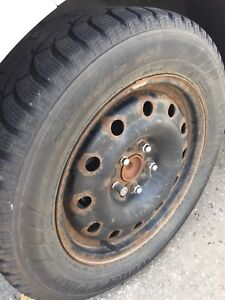 Set of four winter tires and rims, used.
