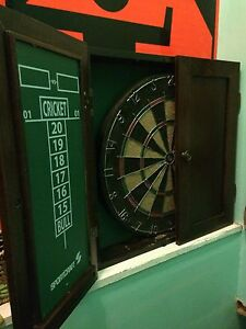 Tart board with a set of darts