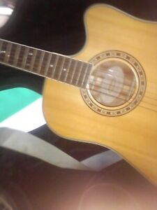Acoustic guitar and hard case pics strap and tuner incl