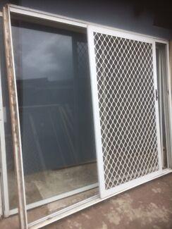 Large white aluminium sliding door