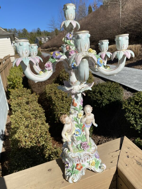 DRESDEN CANDELABRA, 7 CANDLE HOLDERS AND 2 CHERUBS WITH FLOWERS AROUND.
