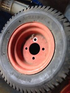 Two garden tractor or snow blower wheels and tires