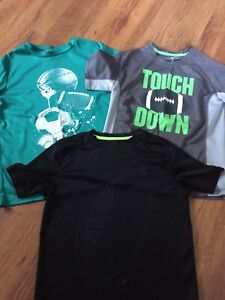 Size 10/12 Football themed t-shirts