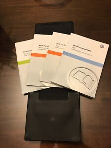 2012 VW Jetta manual (French) in nice leather case