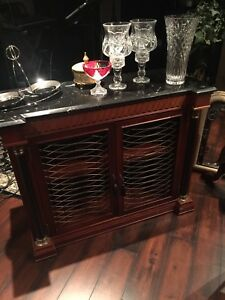 Solid wood cabinet with black marble top