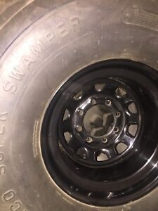 TSL's 44 inch super swampers with rims